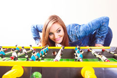 Woman playing table football game Royalty Free Stock Images