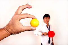 Woman playing table tennis. Yellow ball stock images