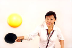 Woman playing table tennis. Yellow ball royalty free stock images