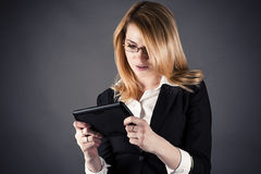 Woman playing on the tablet Royalty Free Stock Photo