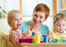 Woman playing and teaching with children Stock Image