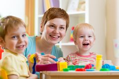 Woman playing and teaching children Stock Photo