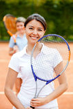 Woman playing tennis Stock Photography