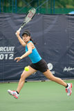 Woman playing tennis . Royalty Free Stock Images