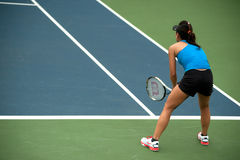 Woman playing tennis . Royalty Free Stock Image