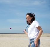 Woman playing tennis at the beach Royalty Free Stock Photo