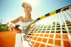 Woman playing tennis. Beautiful sporty girl playing tennis very passionately Stock Photos