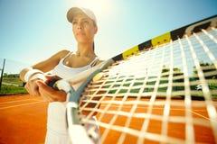 Woman playing tennis Stock Photos
