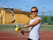 Woman playing tennis. Happy woman smiling on a yennis court Stock Photos