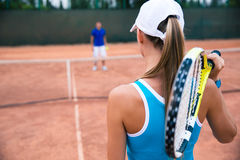 Woman playing in tennis with man outdoors Royalty Free Stock Photo