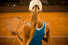 Woman playing in tennis outdoors. Back view portrait of a woman playing in tennis outdoors royalty free stock photo