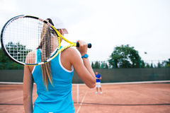 Woman playing in tennis outdoors royalty free stock photography
