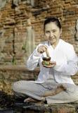 Woman playing a tibetan bowl Stock Photography
