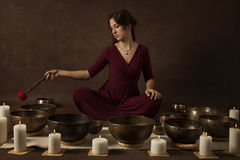 Woman playing Tibetan bowls Royalty Free Stock Photography