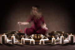 Woman playing Tibetan singing bowls Royalty Free Stock Photo