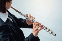 Woman playing transverse flute Royalty Free Stock Images