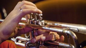 Woman playing trumpet. Trumpet player. Trumpeter playing music jazz instrument. Brass orchestra instrument. Woman plays Stock Photo