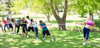 Woman playing tug of war with friends Stock Photos