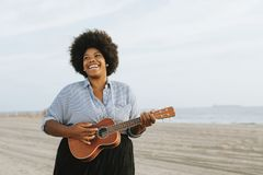 Woman Playing Ukulele royalty free stock images