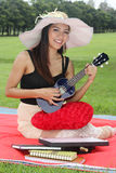 Woman playing ukulele Royalty Free Stock Photo