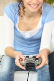 Woman playing a video game Royalty Free Stock Photos