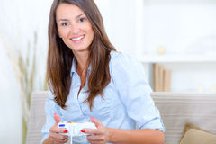 Woman playing video game Royalty Free Stock Image