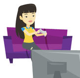 Woman playing video game vector illustration. Asian gamer sitting on sofa and playing video game on the television. Excited young woman with console in hands Stock Image