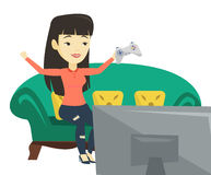 Woman playing video game vector illustration. Happy asian gamer playing video game. Excited woman with console in hands playing video game. Woman celebrating Stock Images