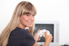 Woman playing video game Royalty Free Stock Photography