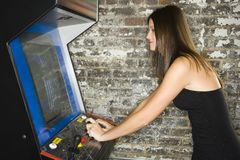 Woman playing video games Royalty Free Stock Images