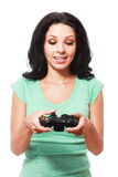 Woman playing videogame Royalty Free Stock Photos