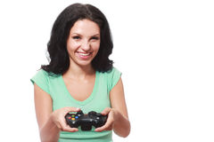 Woman playing videogame Stock Images