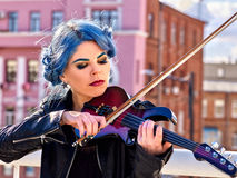 Woman playing violin alone Royalty Free Stock Image