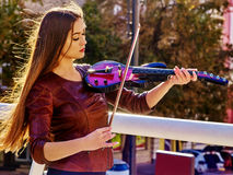 Woman playing violin alone Stock Image