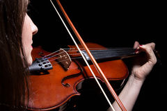 Woman playing on violin from back, close up Stock Image