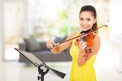 Woman playing violin Stock Photos