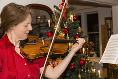 Woman is playing violin Royalty Free Stock Photo