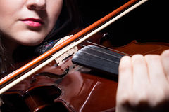 Woman playing on violin, close up Royalty Free Stock Photo