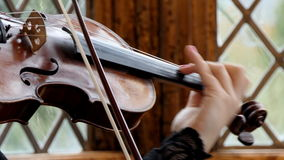 Woman playing violin close-up stock footage