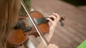 Woman playing violin stock video footage