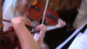 Woman playing the violin stock footage
