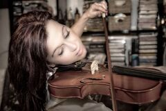 Woman Playing Violin Inside Room Royalty Free Stock Photos