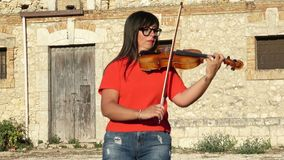 Woman playing violin in outdoor. stock footage