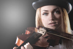 Woman playing the violin Stock Photo