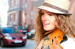 Woman playing violin on the street Royalty Free Stock Photography
