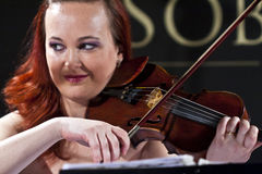 Woman playing the violin at the Vienna Ball Stock Photo