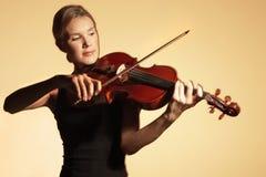 Woman Playing Violin Stock Photography