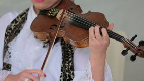 Woman Playing the Violon. Footage of one woman in white blouse playing the violon stock footage