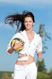 Woman playing volleyball on beach Stock Images