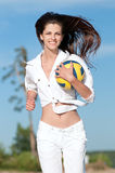 Woman playing volleyball on beach Stock Photos